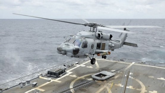 A Sikorsky MH-60R Seahawk takes off from the Arleigh Burke-class Aegis destroyer USS Wayne E Meyer with a recoverable exercise torpedo