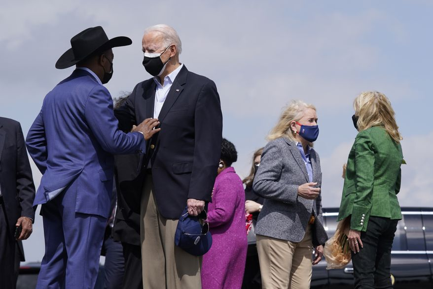 Biden surveys Texas weather damage, encourages virus shots