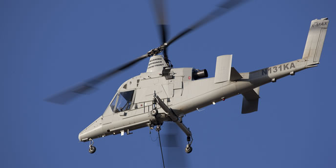 The autonomous K-MAX unmanned helicopter  will provide air transportation for the UGV, which will independently continue the mission relying on its integral sensors and situational understanding. Photo: Lockheed Martin