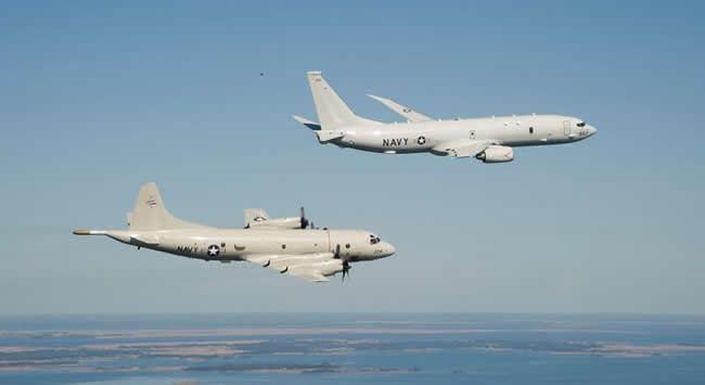 The P-8A arriving at Patuxent River, flying in formation with the P-3C off the coast of Maryland.