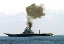 Smoke pillowed from the Vikramaditya as she sailed the Barnets Sea on its first sea trial. Despite the crew's efforts to reach top speed, the vessel didn't make it, due to faulty boiler insulation.