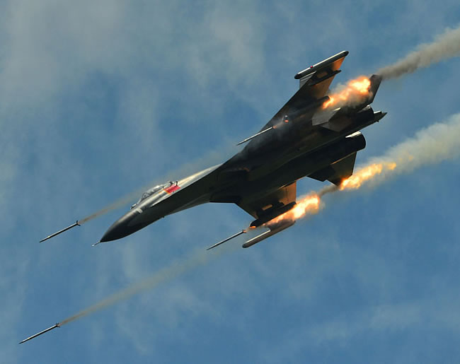 PLAAF J-11 fires rockets on an air-ground mission.