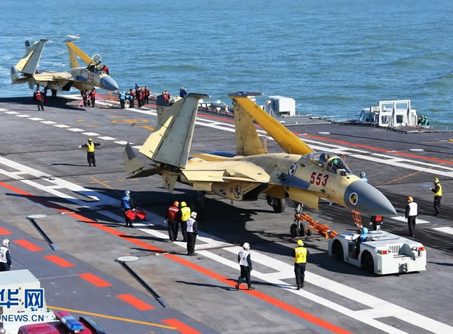 A pair of J-15 jet fighters prepared for flight from the deck of the Chinese aircraft carrier Liaoning. Photo: Xinhua