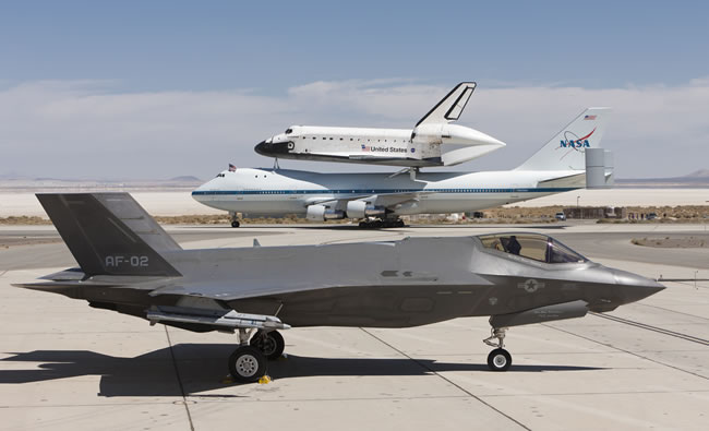 The US Air Force F-35 AF2 at Edwards AFB, Calif., gets an up-close view of Space Shuttle Endeavour on Sept. 20, 2012. Photo: Lockheed Martin