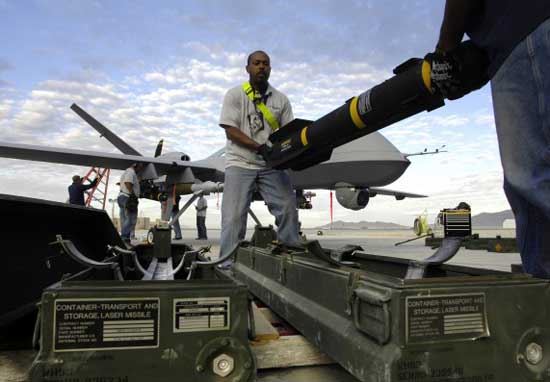 Laser guided bombs and hellfire missiles are loaded on a General Atomics MQ-9 Reaper drone prior to a mission in Afghanistan,