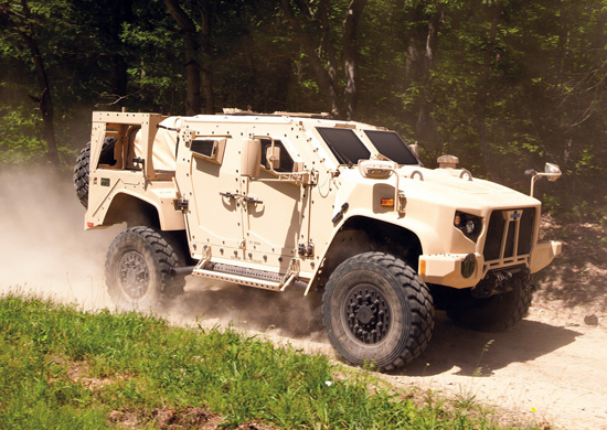 Oshkosh is submitting the Light Combat Tactical All-Terrain Vehicle (LATV) design for its proposed version of the JLTV. The LATV is seen here racing through the SART course at Quantico, June 2013. Photo: Oshkosh.