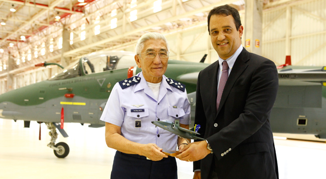 FAB (Brazilian Air Force ) Aeronautics Commander,  General Juniti saito receives the first A-1M modernized jet fighter form Luiz Carlos Aguiar, President of Embraer Defense & Security