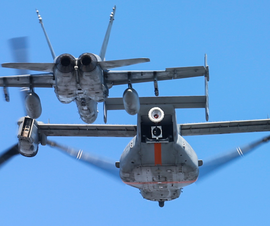 In the August demonstration over north Texas, a V-22 equipped with a prototype aerial refueling system safely deployed, held stable, and retracted the refueling drogue as an F/A-18 Hornet flew just behind and to the side of the aircraft. Photo: Bell-Boeing