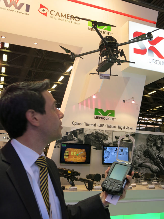 Camero unveiled at Milipol 2013 a new variant of the Xaver 100 wall penetrating radar, configured as a UAV payload. The new payloadcan penetrate ceiling, providing synthesized view of occupants or objects inside the room. Named Xaver Autonomous Imaging Drone AID 100, the new sensor can be carried by standard quadcopters, controlled by remove via Xaver AID 400 ground station. Covering an arc of 120 degrees, the payload penetrates up to 20 meter into the room below. The payload weighs 3.8 kg.