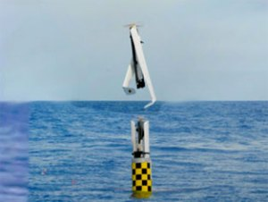 The fuel-cell powered XFC drone is launched vertically into the air, after being fired from the torpedo launch tube of the submerged USS 971 Providence. Photo: NRL