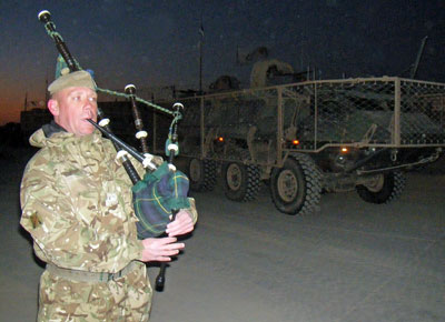 Leaving Gereshk to the bagpipe tune of Caber Feidh, played by Warrant Officer 2 (RQMS(T)) Andrew Lambert, the battlegroup moved north under blue skies and in biting temperatures. Photo: UK MOD, Crown Copyright