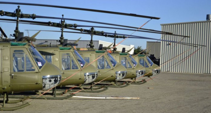 A line of refurbished Huey UH-1H Iroquois helicopters parked at Rice Aircraft in northern California. The Huey is a popular platform operating with many third world air forces.  Photo: Rice Aircraft