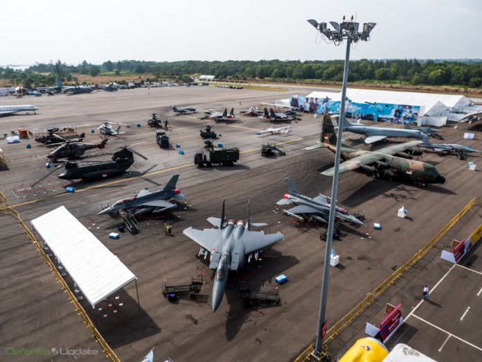 A group photo showing the Singapore Air Force military aircraft park, including F-16E, F-15SG, CH-47 Chinook, Apache AH-64D, S-70B maritime helicopter, Heron I and hermes 450 drones, Gulfstream V CAEW airborne early warning aircraft and C-130H. The RSAF is celebrating its 45th anniversary this year.