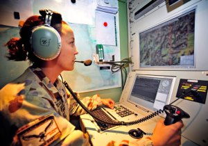 Heron detachment Payload Operator, Flight Lieutenant Zalie Munro-Rustean, in the Ground Control Station at the Heron compound at Kandahar Airfield. Photo: RAAF Paul Berry