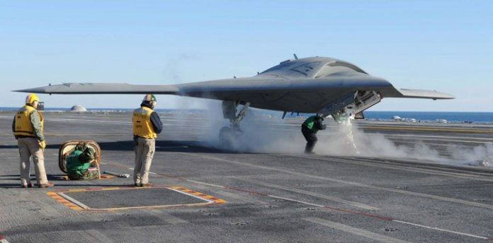 The X-47B Unmanned Combat Air System (UCAS-D) completes preparations for launching aboard the aircraft carrier USS Theodore Roosevelt (CVN 71). Theodore Roosevelt is the third carrier to test the tailless, unmanned autonomous aircraft's ability to integrate with the carrier environment. The future UCLASS will be optimized to operate with the new Ford Class carrier (CVN-78) fitted with electrically rather the conventional steam powered catapult, enabling safe handling of lighter aircraft. (U.S. Navy photo by Heath Zeigler)