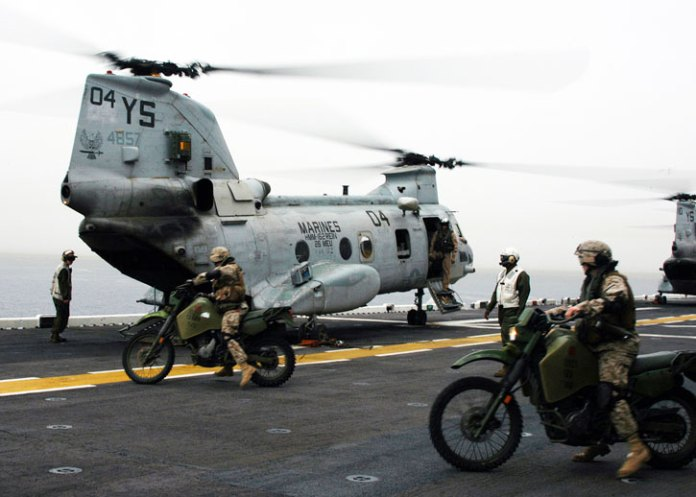 26th MEU scouts on board an LHD at the Mediterranean load two KLR-250D8 motorcycles onto a CH-46 helicopter. Photo: USMC