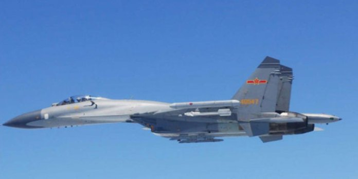 Chinese Air Force Su-27s got as close as 50 meters to a Japanese surveillance aircraft over Senkaku islands. Photo: Japan's Self defense Force