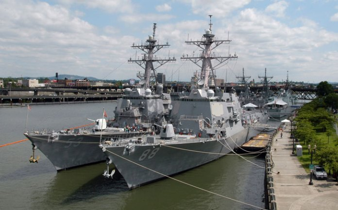 Guided missile destroyers USS John Paul Jones (DG 53) and USS Preble (DDG 88) moored in Portland for the 99th Rose Festival. The John Paul Jones, originally based in San Diego will now deploy to Hawaii to become the Navy's newest missile defense test ship. U.S. Navy photo by Photographer's Mate 1st Class Bruce McVicar.