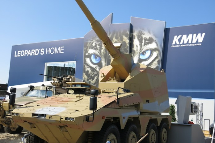 The autonomous gun system turret developed by KMW is displayed here at Eurosatory 2014 on the Boxer chassis. This is the first public appearance of this configuration, which seems to carry the Boxer to the extreme. The AGM offers fully autonomous operation of the 155 /52 Cal artillery unit, controlled by the crew seated in the front section of the vehicle. Other configurations provide more spacious cabins for the crew.