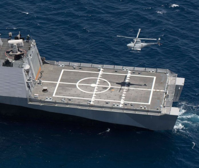 MQ-8B Fire Scout unmanned helicopter prepares to land on the littoral combat ship USS Freedom (LCS 1) off the coast of Southern California. The training marked the first time a littoral combat ship, an MQ-8B Fire Scout unmanned helicopter and an SH-60R Sea Hawk helicopter conducted integrated training. Photo: US Navy