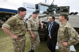 Left to right Lt General Chris Deverill Chief of Materiel Land, General Sir Peter Wall Chief of the General Staff, Roddy Malone Scout Team Leader and Major General Robert Talbot Rice in front of the Scout vehicle at today's DVD 2014 event. Photo: MOD, Crown Copyright.