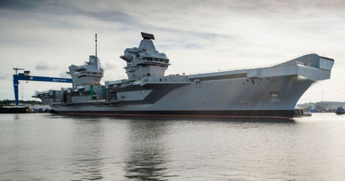 In an operation that started earlier last week, the dry dock in Rosyth near Edinburgh was flooded for the first time to allow the 65,000 tonne HMS Queen Elizabeth aircraft carrier to float. Teams will now continue to outfit the ship and steadily bring her systems to life in preparation for sea trials in 2016. Photo: UK MOD Crown Copyright