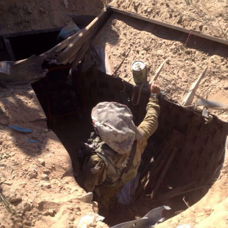 An IDF combat engineer inspects a tunnel uncovered in Gaza. Photo: IDF