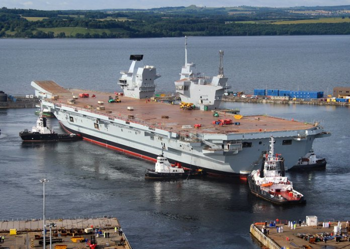 It then took only three hours this morning to carefully manoeuvre HMS QUEEN ELIZABETH out of the dock with just two metres clearance at either side and then berth her alongside a nearby jetty. Photo: UK MOD, Crown Copyright