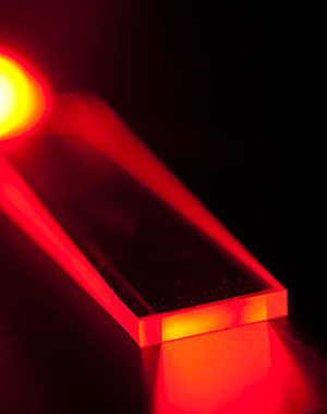 According to raytheon, the patented Planar Wave-Guide architecture enables the implementation of single aperture optical design; without the use of complex optical beam combining elements, delivering high beam quality, and scalability beyond 200 kW output power. The design also features efficient heat removal and thermal management capability, yielding compact size, light weight and modularity. Photo: Raytheon