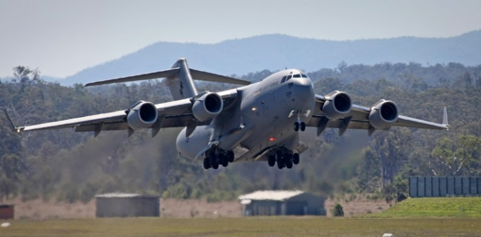 A Royal Australian Air Force (RAAF) C-17A Globemaster strategic transport aircraft departs RAAF Base Amberley, destined for the Middle East-based RAAF Air Task Group. Photo: Australian DOD by Ben Dempster.