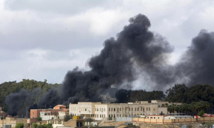 Smoke pillars over the town of Derna in Eastern Libya, after an air attack targeting ISIS aligned terrorist groups took over the city. Photo: AFP