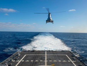 An MQ-8B Fire Scout unmanned autonomous helicopter from the Magicians of Helicopter Maritime Strike Squadron (HSM) 35, Detachment 1, lifts off the flight deck of the littoral combat ship USS Fort Worth (LCS 3) during flight operations. HSM-35 is the Navy's first composite expeditionary helicopter squadron. Fort Worth departed its homeport of San Diego Nov. 17 for a 16-month rotational deployment to Singapore in support of the Navy's strategic rebalance to the Pacific. Photo: U.S. Navy by Antonio P. Turretto Ramos
