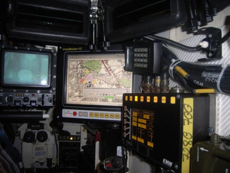 The commander's position inside the Leopard 2A7 showing the different displays of the fire control computer, tactical picture and thermal/electro-optical (day/night) sight.