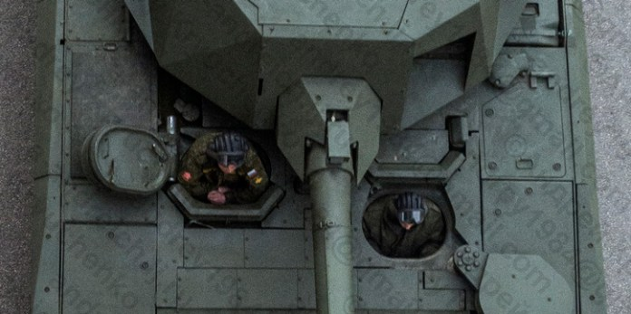 The crew seating arrangement in the T-14. The commander is in the right side position, the driver in the left and gunner in the position with closed hatch behind the driver. The turret must be turned sideways to enable the gunner to open his hatch. It is likely that in emergency he can escape from the driver's hatch.