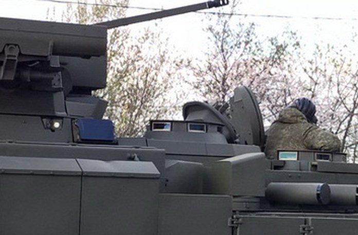 The commander and weapon operator both have vision blocks surrounding their cupola, providing relatively good peripheral vision under armor. For complete coverage, panoramic cameras are positioned around the vehicle. One pair of these cameras can be seen left of the flat sensor under the Kornet missile launcher tubes.