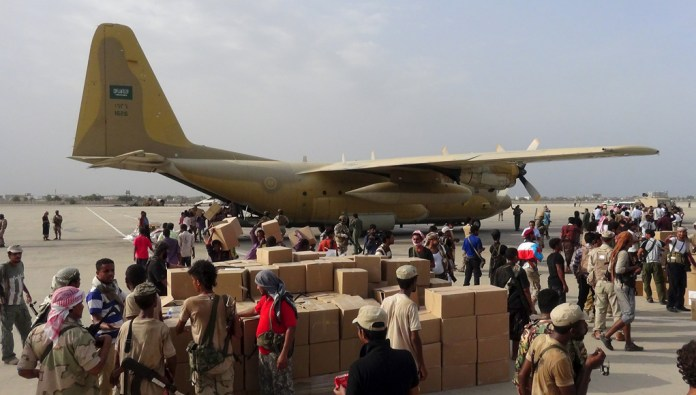 Royal Saudi Air Force C-130 delivers supplies to the International airport of Aden, Yemen, recently taken by Yemeni forces loyal to ousted president  Abd Rabbuh Mansur Hadi