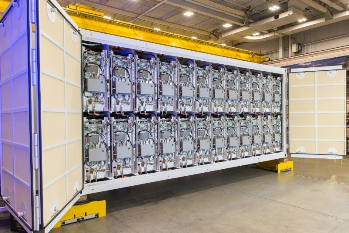 Raytheon has completed the first examples of containerized pulse power packs designed to support field tests of the electromagnetic rail gun. Photo: Raytheon.