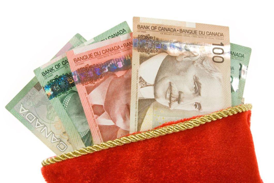 Canadian dollar bills in pouch