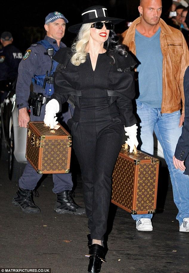 Lady Gaga carries Louis Vuitton luggage