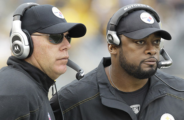 Pittsburgh Steelers head coach Mike Tomlin, right, and offensive coordinator Bruce Arians watch from the sidelines during the second quarter of an NFL football game against the Cincinnati Bengals in Pittsburgh, Sunday, Dec 4, 2011. The Steelers won 35-7. (AP Photo/Gene J. Puskar)