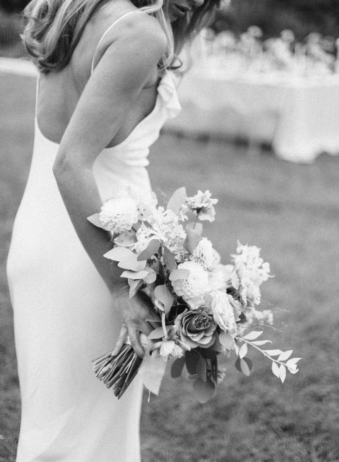 Elegant bride in her flowing wedding dress holding a bouquet of flowers for her wedding at Villa Belrose, St tropez