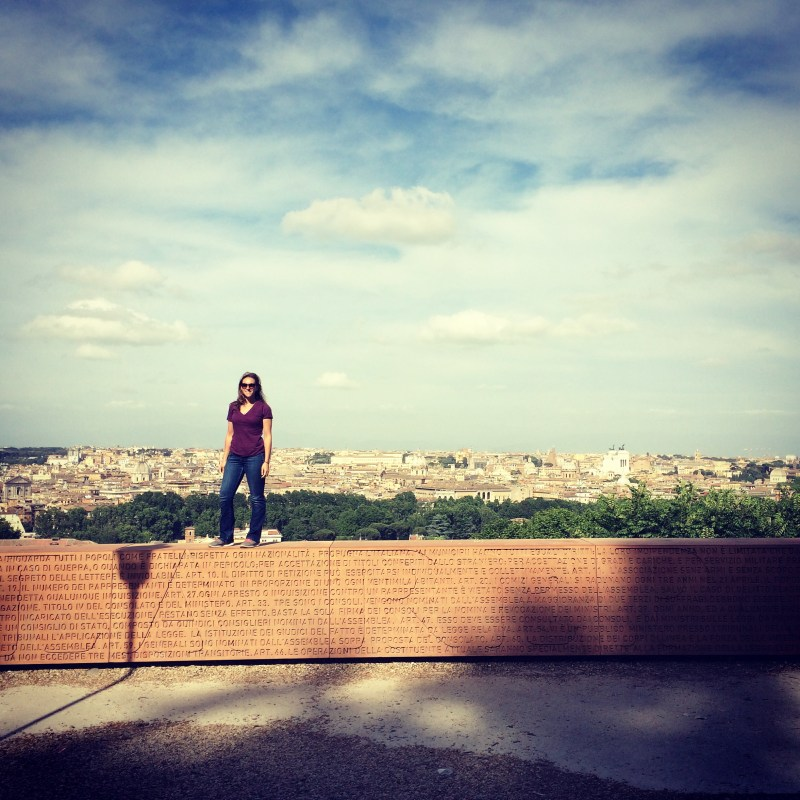woman standing on top of wall