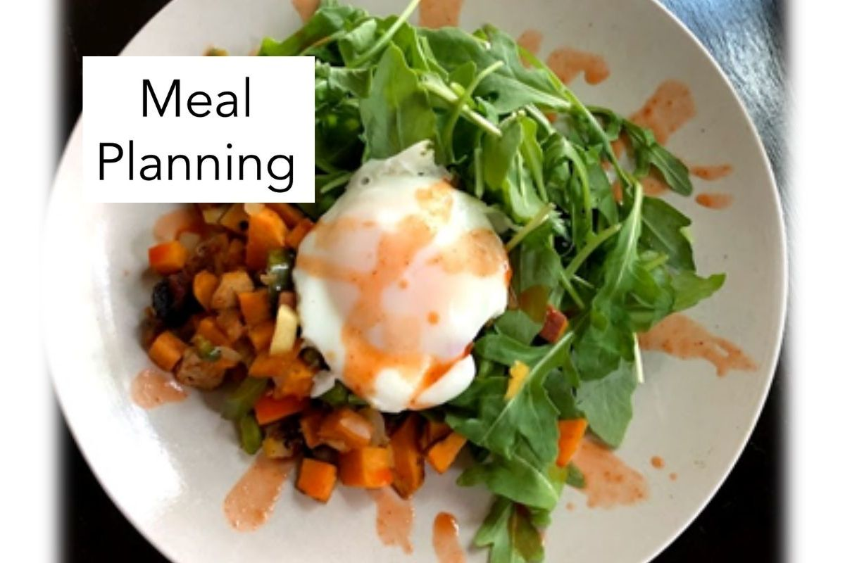 egg on arugula with sweet potato hash with the words meal planning