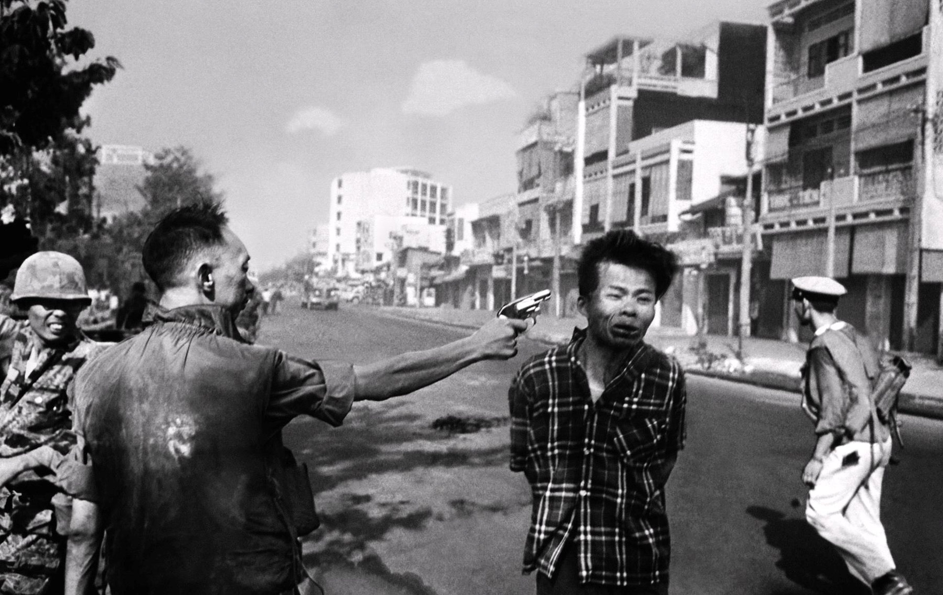 Reference Image: General Nguyen Ngoc Loan Executing a Viet Cong Prisoner in Saigon taken by photograper Eddie Adams. Romeo Alaeff, 'Smells Like Napalm,' 2007. 60 x 40 in. (152,4 x 101,6 cm.) Limited Edition Serigraph Print. Edition 10. From the series, 'War on the Brain.' This work employs famous journalistic photos as well as a movie still from 'Apocalypse Now' to invoke impressions of Vietnam as seen through the media, which was responsible in part for changing public opinion about the war.