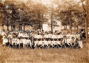 A photo of the Bradleyville Woodsmen of America, with the two-story Bradleyville School in the background. (photo courtesy of D. Nelson Mackey)