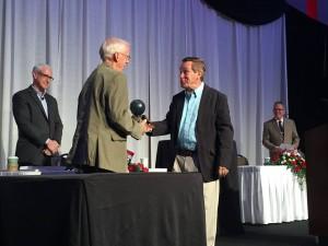 Dr. Jay Scribner presenting the Don Gabriel Kindgom Builder Award to Herb Smith