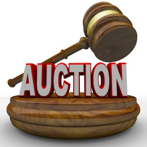 A gavel comes down on the word Auction to symbolize the final bid being called