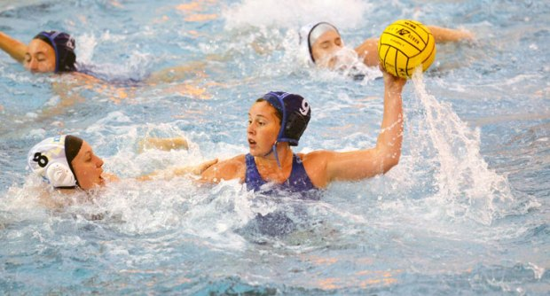Greenwich Aquatics player, Larissa Hodzic (with ball) competes in a match at the NEZ qualifier. (photo courtesy of YMCA of Greenwich)