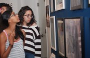 Students review the art selected for the 2014 iCreate exhibition at the Bruce.