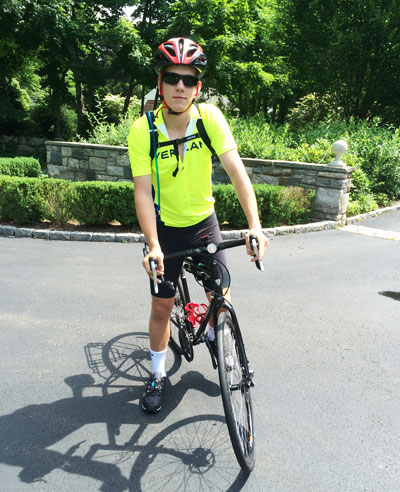 Greenwich native and Brunswick School student Henry Harris on the bike that he will be using to ride across the USA while raising money for CHAMPS.